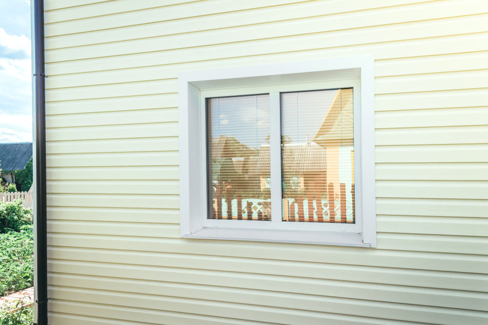 House with a vinyl window (5 Benefits of Replacing Your Windows With Vinyl )